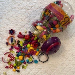 B. Toys Pop-Arty! Jewelry Making Kit